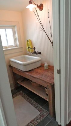 Cool powder room idea. Just missing the mirror!