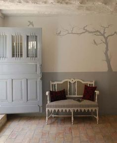 terracotta floor tiles, bird wall painting, light gray wall paint for entry room decorating