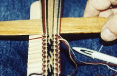 Slide showing a close up of traditional Latvian backstrap weaving as demonstrated by Anita Apinis-Herman. Anita is second generation Latvian weaver, she was taught by her mother Anna and then undertook further training at the Melbourne College of Textiles.  (circa 1985)