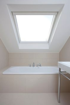 bathtub under the eave - think I'd prefer the window going horizontally