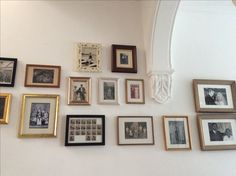 Eclectic picture frames, old photos In old  salvages from scrap market and charity shops