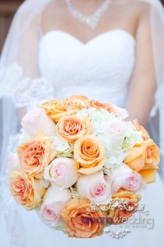 Bridal bouquet with hydrangea, pink rose and peach garden roses by Amara Wedding