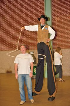 Amaze your guests with a trick roper on stilts!