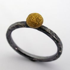 Todd Pownell: , Ring in oxidized sterling silver with 18k yellow gold textured bead. Size 6.75 (may be sized to fit)