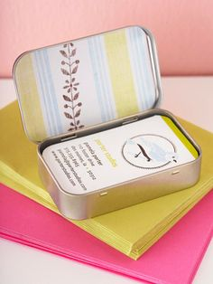 reuse an old mint container to hold your business cards.