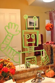 robots on the mirror - fun party decoration!  Workshop of Wonders VBS Decorations