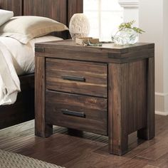 This nightstand features a solid acacia construction with a unique contemporary design. The rich, brown finish and metal bar drawer pulls give this nightstand a look that you will be sure to love. Inc