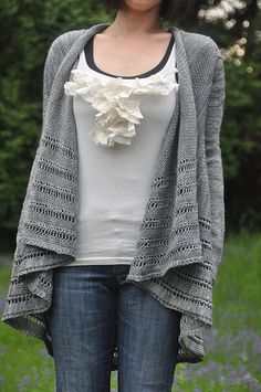 This is a very light and drapey cardigan, worked with fingering yarn at a fairly loose gauge. It features an A-line shape, with draped fronts and a very simple lace pattern in the body. This pattern is absolutely seamless and it includes directions for a short-sleeved and a long-sleeved version.