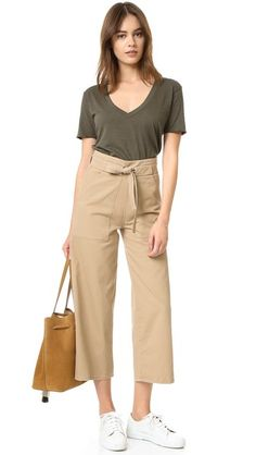 Cropped Loup pants with a high rise. Optional ties. Slant hip pockets. Hidden side zip.