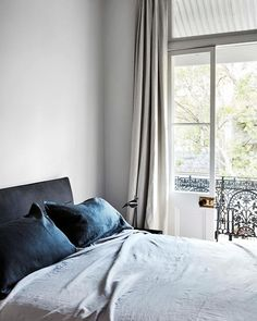 One of the bedrooms in this renovated Victorian terrace enjoys plenty of light filtering in through a set of French doors Guest Bedroom Decor, Farmhouse Bedroom Decor, Office Interior Design, Home Interior, Interior Doors, Interior Paint, French Doors Patio, Victorian Terrace, Victorian Homes