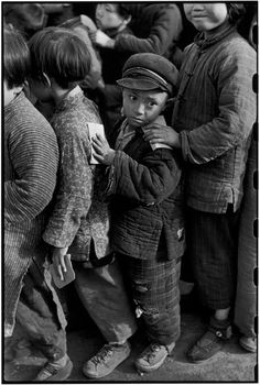 CHINA. Shanghai. 1949. Children await rice distribution. They belong to a…