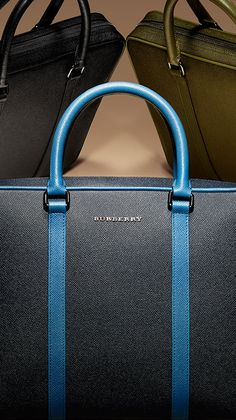 Briefcases, wallets and digital cases in bright shades of blue. Find the perfect gift this festive season at Burberry.com #burberrygifts #christmas