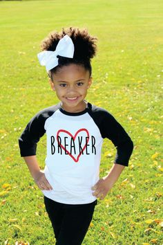 How cute is this Valentine's Day shirt for your little one? Raglan style tee is 3/4 sleeves. Girls style has red glitter heart.