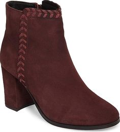 Athena Alexander Women's Shoes in Wine Suede Color. Leather stitch detailing brings a rustic, Western element to a lush suede bootie lifted by a chunky wrapped heel.