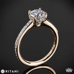 This Diamond Engagement Ring is from the Ritani Classic Collection.  It features a 4 prong head that holds the round diamond center of your choice and micropave set Round Brilliant Diamond Melee (0.20ctw; G/H VS) along the gallery and shank. The width of this ring is 2.0mm. Select your diamond from our extensive online diamond inventory. Please allow 12 Business Days for completion. If you have any questions regarding this item then please contact one of our friendly diamond and jewelry…