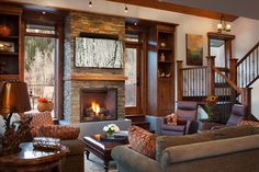 PAINTING ABOVE FIREPLACE....BIRTH TREES...Tree Haus Renovation - rustic - living room - denver - WEST ELEVATION ARCHITECTS INC