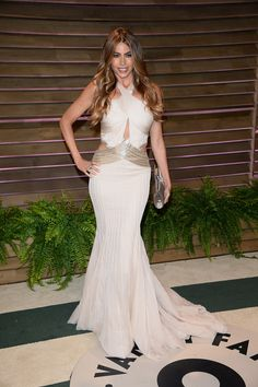 Always count on Sofia Vergara for a bombshell look. The actress picked snowy white with a crisscross halter neckline that showed a spot of skin. Silver banding above her hips only served to accentuate her curves more.