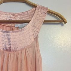 Pink tank top Stretchy soft material with silk material along neckline. Button back. Blush pink color. Never worn. Charlotte Russe Tops Tank Tops