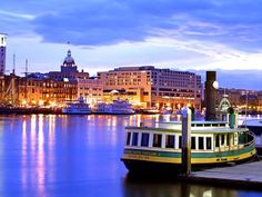 A view from across the river at Savannah,Ga. USA   ( Note the river shuttle in the foreground )