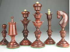 Reproduction Antique Chess Set Bud Rose Wood Pieces Repro. http://www.chessbazaar.com/chess-pieces/wooden-chess-pieces/reproduction-antique-chess-set-bud-rose-wood-pieces-repr.html
