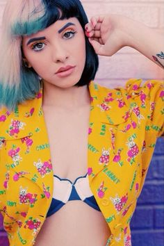 {FC: Melanie Martinez} Hey I'm Melanie most people call me Mel or Melly your choice call me whichever. I'm 17 and single and I also single and record some songs