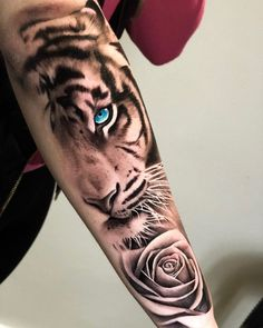 Tattoo of a beautiful face with pink tiger on forearm Tiger Forearm Tattoo, Tiger Eyes Tattoo, Mens Tiger Tattoo, Tiger Tattoo Design, Forearm Sleeve Tattoos, Mens Leg Tattoo, Tigergesicht Tattoo, Forarm Tattoos, Dope Tattoos