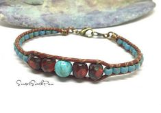 Beaded Leather Bracelet, Southwest Bracelet, Leather Cuff, Beaded Bracelet, Minimalist Jewelry, Beaded Jewelry, Boho, Hippie, Turquoise Cuff A thin beaded leather cuff, featuring Czech glass beads carefully double stitched onto Brick colored leather cord. Finished with bronze metal