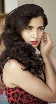 Tuba Büyüküstün / (born 5 July 1982), is a Turkish actress.