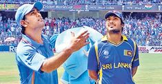 MS Dhoni and Kumar Sangakkara at the toss of the 2011 Cricket World Cup final at Mumbai