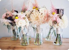 garden flowers in old jars for table pieces