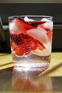 Your New Favorite Warm-Weather Drink: 2 parts Dolin Blanc vermouth to 1 part seltzer, with a subtle sweetness (and some color) thanks to a thin-sliced strawberry