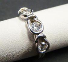 14K WHITE GOLD THREE STONE DIAMOND BAND RING ROUND .50 cttw LOVE KNOT SIZE 6