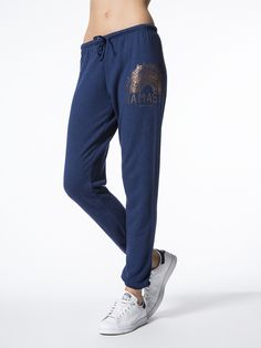 The Namaste Sun Favorite Sweatpant by Spiritual Gangster is a low-rise sweatpant in navy. Featuring a drawstring tie at waist, gold foil graphic at hip and elastic at ankles.