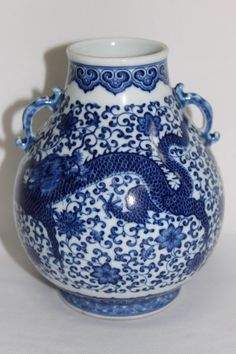 Chinese Blue and White Porcelain Twin Handled Vase, of baluster form, decorated with a rampant dragon amongst peony scrolls, on circular foot, seal mark to base, h 16cm
