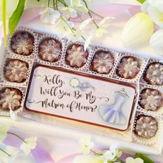 Will you be my matron of honor gift. A personal and beautiful way to propose to your matron of honor. Choose from 10 different colors for your dress and bouquet. Personalize it with your matron of honors name to make a truly special. It even has sparkling sugar to add a touch of bling. This unique gift of decadent chocolates, is presented in a white gift box and tied with a bow. By DiamondChocolates