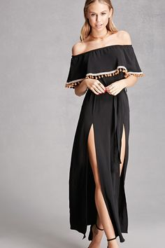 A woven maxi dress featuring an off-the-shoulder design, flounce layer with embroidery and pom pom trim, a belted waist, and an M-slit skirt. This is an independent brand and not a Forever 21 branded item.