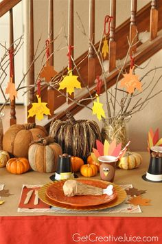 Easy DIY kids thanksgiving table ideas - place settings, crafts, placecards, printable placemats, centerpieces, decorations, and activites! tons of ideas for your kids this thanksgiving!