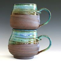 "ceramic stoneware mugs ...this shape is great for ""cupping "" your hands around a warm drink on a frosty day.."