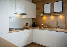 small kitchen ideas handleless white cabinets oak wall panels wood countertop