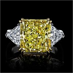 9 carat fancy yellow radiant center stone with side trillions