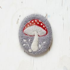 Felted mushroom brooch from Etsy. she has lovely birds and cats too!