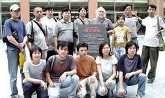 Tom R. Chambers seen with professional photographers and the photography club members at Sheng Da College, Zhengzhou, China.