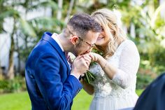 Beautiful moment during the ceremony of the groom kissing the bride's ring
