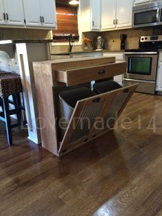 Please dont buy this just by looking at pictures. Read the listing. We want you to be happy with your purchase and have no surprises when your new trash cabinet arrives! COLOR: The color of this bin is Minwax golden oak and the door is barn metal.If you choose a silver handle, you will get