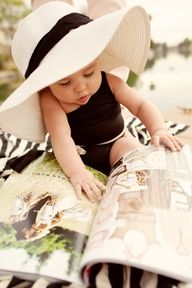 Could this be Evvy's future?  Big hat, cute bathing suit and perusing Vogue.