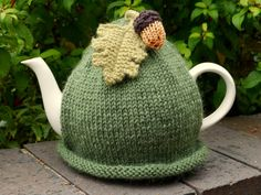 Hand knitted green tea cosy with acorn and oak leaf attached. Made with Sirdar Wool Rich Aran which will keep the teapot nice and warm. Will fit a