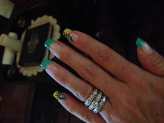 Teal yellow nails
