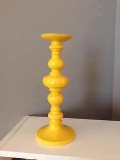 Yellow candle holder from Home Goods for yellow, grey, white bedroom.