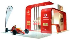 Clean & cool custom stand . Vodafone Expo Stand - builder unkown