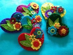 Jess of BettyOctopus has been using her felt to make lots of brooches, and amazing textile pictures felt-flowers Felt Flowers, Fabric Flowers, Diy And Crafts, Crafts For Kids, Fabric Hearts, Christmas Hearts, Heart Crafts, Felt Brooch, Heart Ornament